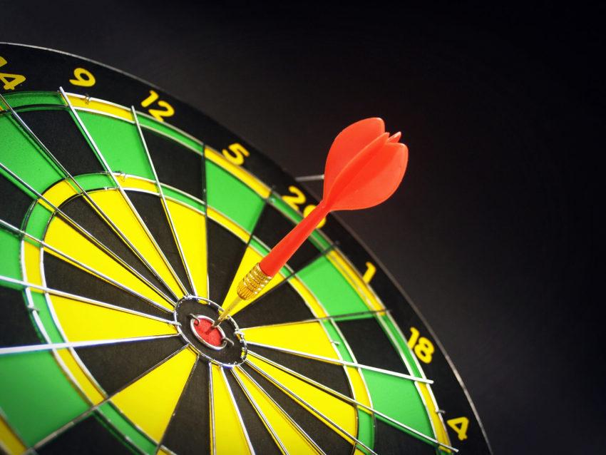 Dart hitting bullseye.